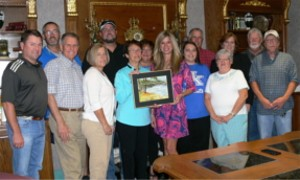 Cox Interior, Inc. accepts the 2016 Environmental Sustainability Award from Lissa McCracken, Executive Director of KPPC (third from right) in recognition of the company's sustainability efforts.